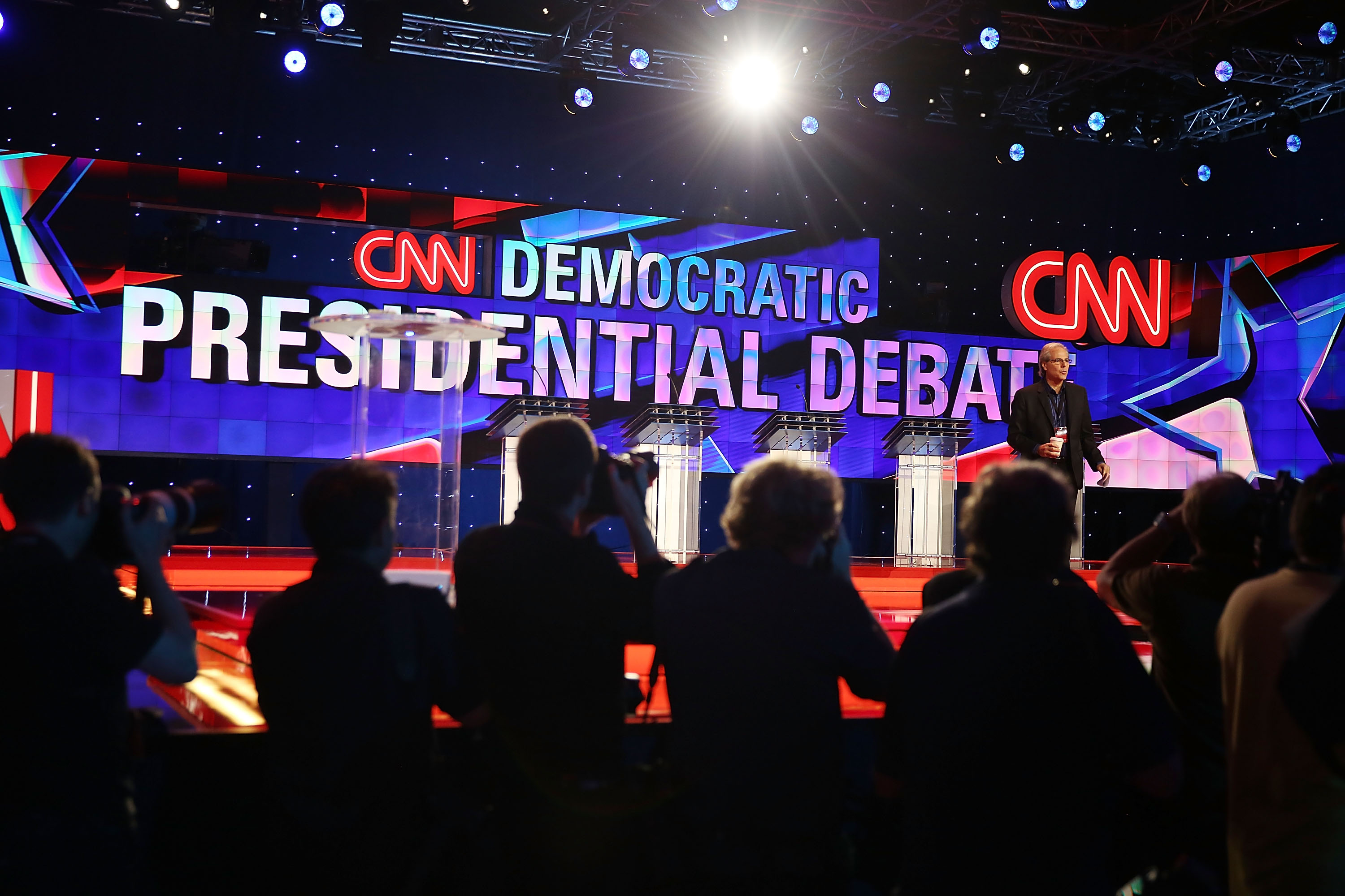 LAS VEGAS, NV - OCTOBER 13:  Journalists check the debate stage during a walk-through before the Democratic Presidential candidates arrive for their CNN Facebook Democratic Debate this evening at the Wynn Las Vegas on October 13, 2015 in Las Vegas, Nevada. Democratic presidential candidates are participating in the party's first presidential debate.  (Photo by Joe Raedle/Getty Images)