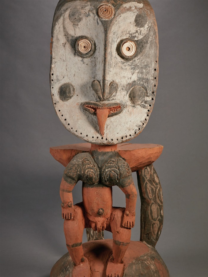 "From YaleNews: ""Carved from a single piece of wood and standing nearly four feet tall, this debating stool depicts a standing male figure with inlaid shell eyes. Never designed for sitting, the stools are used during formal debates by the Iatmul people of the middle Sepik River region of Papua New Guinea. The debates occur in the presence of the village's most prominent ancestor, depicted on the stool's back."""